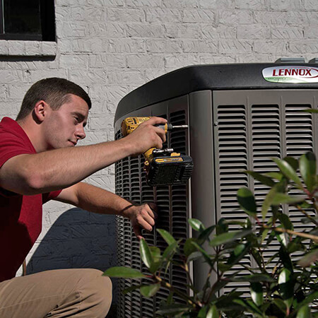 Technician Installing an Air Conditioner